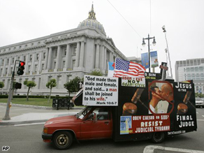 A protest truck against same sex marriages circles around City Hall in San Francisco, Monday.