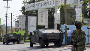 Members of the Mexican navy last week guard the complex where Arturo Beltran Leyva was killed.