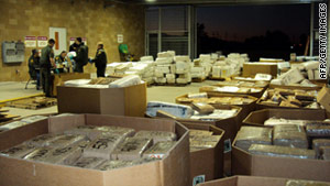 U.S. agents weigh marijuana seized from a tractor-trailer in San Diego, California, last Thursday.