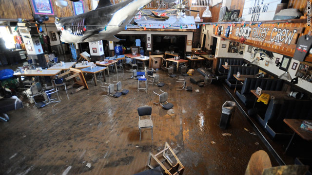 Floodwaters from weekend storms damaged restaurants such as Joe's Crab Shack in downtown Nashville.