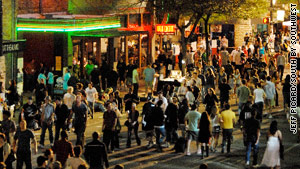 People flood 6th Street in Austin, Texas, during the annual South by Southwest Conference.