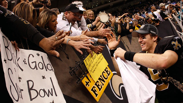 Saints quarterback Drew Brees celebrates with fans at the Superdome after New Orleans advanced to the Super Bowl.