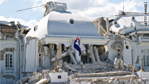 """""""I'm not Haitian, but it just hurts to see that,"""" John Restituyo says of the damaged presidential palace."""