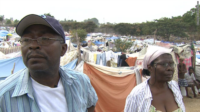 Michel and Eliane Clervil survey a camp shortly after the January 12 earthquake in Haiti. Soon more tragedy would strike