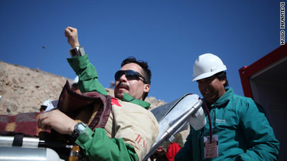 After months deep underground, all 33 trapped miners are free. The 12th miner to emerge, Edison Peña, is pictured here.