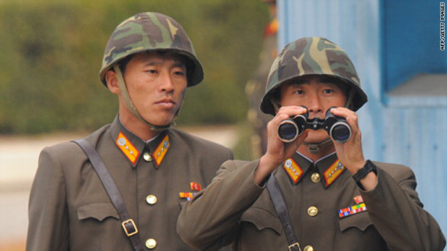 North Korean soldiers stand guard in Panmunjom in the buffer zone between the two Koreas on October 20, 2010.