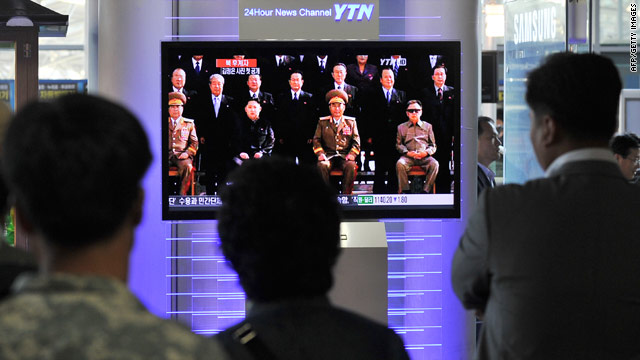 South Koreans watch a broadcast of a photo that includes Kim Jong Un, Kim Jong-Il's son, released by KCNA in September.