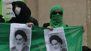Iranian opposition supporters demonstrate at Tehran University's campus in December.