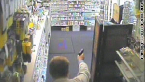 Surveillance video shows pharmacist Mike Donohue defending his drugstore with a pistol two years ago.