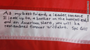 Kevin Gill wrote this note on an American flag signed by  Andrew Wilfahrt's comrades.