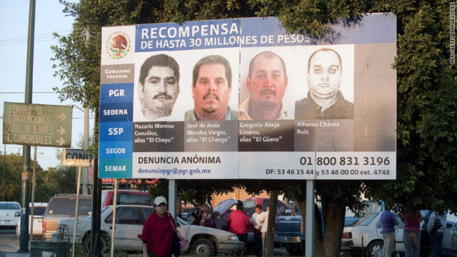 A billboard in Morelia, Mexico, shows portraits of La Familia Michoacana cartel members, including now-captured Jose Mendez.