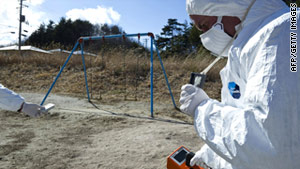 Greenpeace members monitor radiation in Iitate on Sunday, 40 kilometers from the damaged Fukushima Daiichi plant.