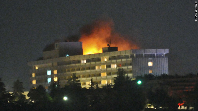 Flames light up the night after a Taliban attack on the Hotel Inter-Continental in Kabul, Afghanistan, on June 29.