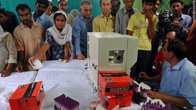 Pakistanis give blood samples at a dengue fever medical camp in Lahore on September 13, 2011.