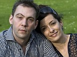 Fighting for control: Neil Barker with his girlfriend Valeria Carli