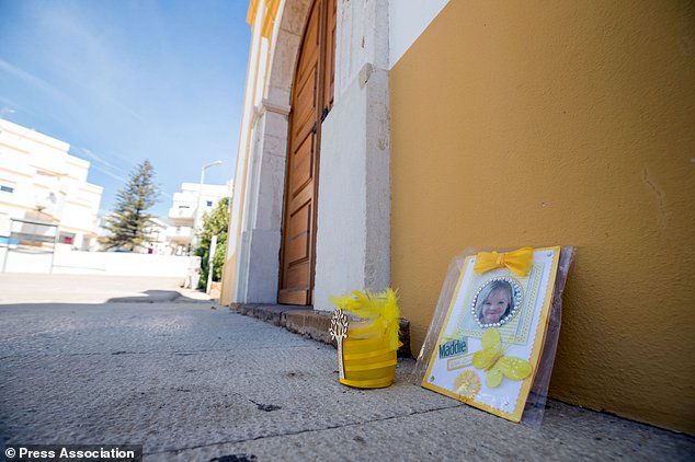 A tribute to Madeleine McCann is left outside the Church of Nossa Senhora da Luz in Praia Da Luz, Portugal (Steve Parsons/PA)