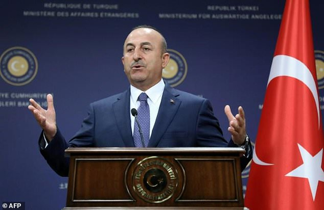 Turkish Foreign Minister Mevlut Cavusoglu speaks at a news conference in Ankara, on June 5, 2017
