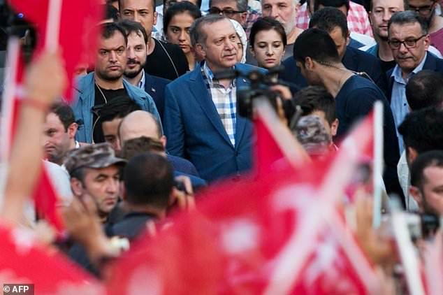 Turkish President Recep Tayyip Erdodan (C) arrives for a speech to the crowd near his Istanbul house last July 16 as his forces regained control after a spectacular coup bid by discontented soldiers that claimed more than 250 lives.