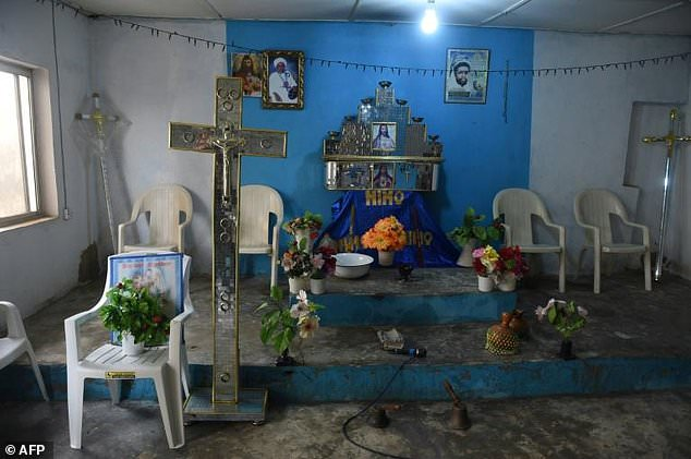 Pictured: The pulpit is abandoned after shadowy gang dubbed the Badoo killed four worshippers in the Crystal Church of God at Owode Onirin in Lagos
