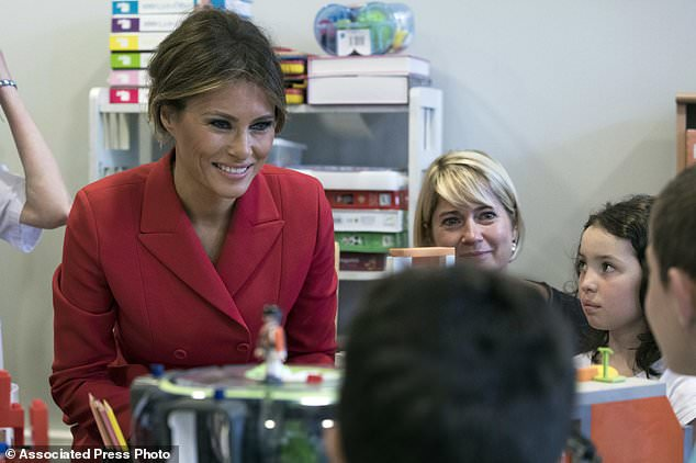 First Lady Melania Trump talks to children as she visits the Necker hospital, France's biggest pediatric hospital in Paris, Thursday July 13, 2017. Melania Trump is touring the hospital shortly after her arrival in France with President Donald Trump aboard Air Force One. (AP Photo/Kamil Zihnioglu)
