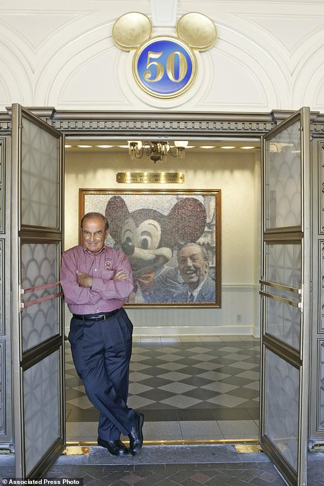 "FILE - In this July 11, 2005 file photo, Imagineering Vice Chairman and Principal Creative Executive Martin ""Marty"" Sklar poses in front of a picture of Mickey Mouse and Walt Disney at Disneyland in Anaheim, Calif. Sklar, one of the central figures behind Disney's theme parks around the world, has died.  Sklar had a role in the opening of every Disney park, starting with the original Disneyland in 1955. A Disney statement said he died Thursday, July 27, 2017, at his Hollywood Hills home at age 83. (AP Photo/Jae C. Hong, File)"