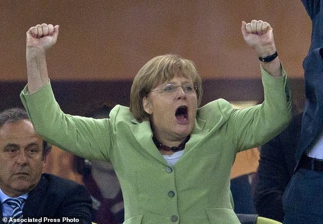 FILE - In this June 22, 2012 file photo German Chancellor Angela Merkel celebrates during the Euro 2012 soccer championship quarterfinal match between Germany and Greece in Gdansk, Poland. Germany won 4-2. Merkel is favored to win a fourth term in Germany's Sept. 24, 2017 election. (AP Photo/Gero Breloer, file)