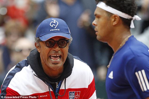 Captain of France Yannick Noah shouts instructions to Wilfried Tsonga of France during their Davis Cup semifinal against Serbia at the Pierre Mauroy stadium in Lille, northern France, Sunday, Sept. 17, 2017. (AP Photo/Michel Spingler)