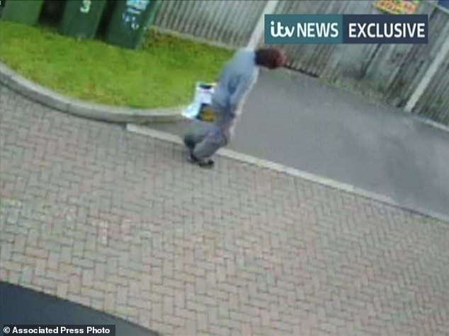This image made from CCTV video obtained by ITN on Sunday Sept. 17, 2017, shows what they say is a person leaving the property in Sunbury, England, on Friday, which was raided in connection with the subway bombing in London. British broadcaster ITN have released CCTV footage of what they say shows a person leaving the property in Sunbury-on-Thames where police carried out a raid in connection with Friday's bombing in London. (ITN via AP)