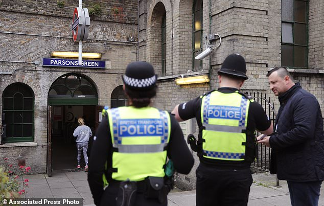 Police forces guard the entrance following Friday's incident on a tube at Parsons Green Station in London, Sunday, Sept. 17, 2017. A manhunt is under way after an improvised explosive device was detonated on a crowded subway car, injuring at least 29 people. (AP Photo/Frank Augstein)