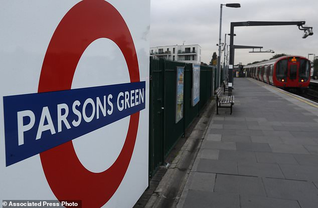 A train pulls in to the platform at Parsons Green tube station in London, Monday, Sept. 18, 2017. A bucket wrapped in an insulated bag caught fire on a packed London subway train at Parsons Green station on Friday Sept. 15, police are treating it as a terrorist incident. (AP Photo/Kirsty Wigglesworth)