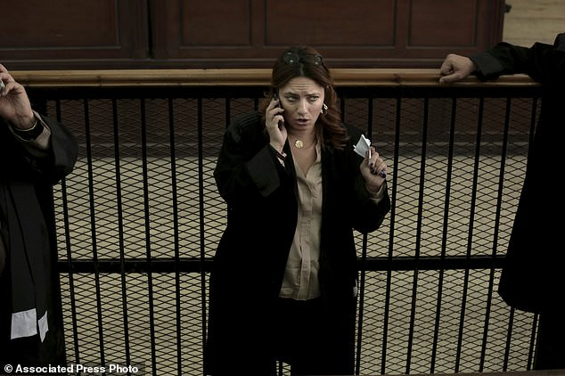 FILE - In this Thursday, Dec. 4, 2014 file photo, Egyptian lawyer Ragia Omran speaks on her mobile phone after a trial session of activists facing charges on organizing unauthorized protests, at a courtroom in Cairo, Egypt. Omran won a European prize for her work representing political prisoners and torture victims as well as advocating for women's rights. She was chosen from among 15 rights defenders from around the world to receive the Franco-German Prize for Human Rights and the Rule of Law. (AP Photo/Nariman El-Mofty, File)