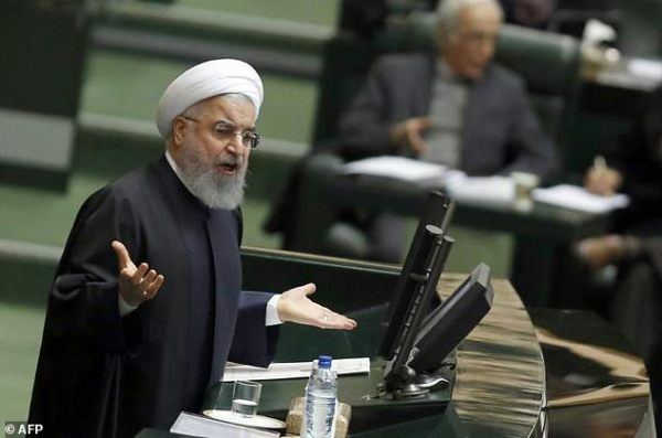 Iran's Rouhani sees major economic growth next year ...