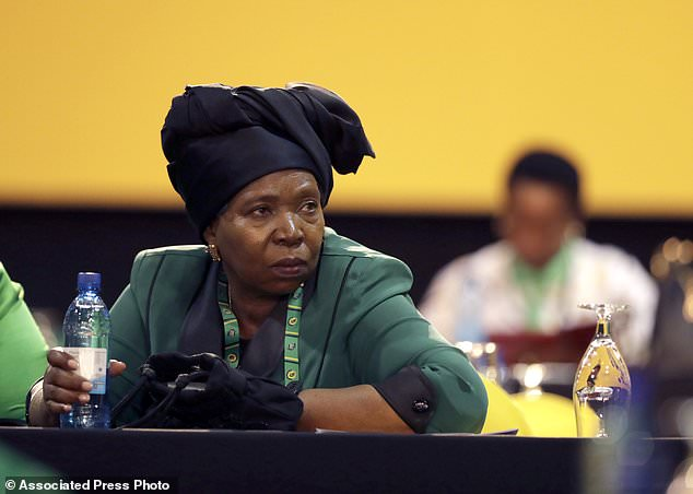 Front runner and former wife of President Jacob Zuma, Nkosazana Dlamini-Zuma, and delegates wait for the delayed start of the ruling African National Congress (ANC) elective conference in Johannesburg, Saturday, Dec. 16 2017. The fight to replace South Africa's scandal-prone President Jacob Zuma began Saturday as thousands of delegates of the ruling African National Congress gathered to elect a new leader. (AP Photo/Themba Hadebe)