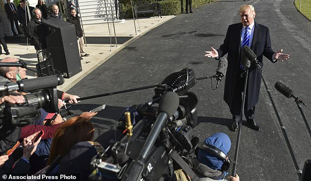 President Donald Trump talks with reporters as he departs from the South Lawn of the White House via Marine One in Washington, Saturday, Dec. 16, 2017, to spend the weekend at Camp David in Maryland. (AP Photo/Susan Walsh)