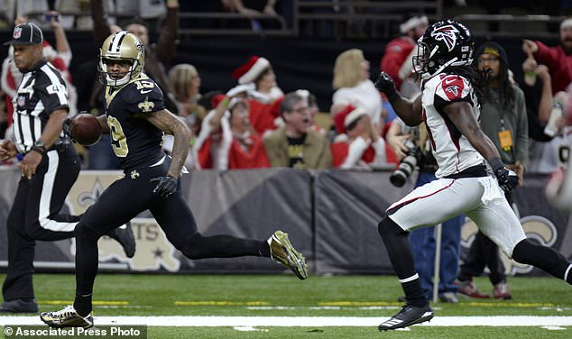 New Orleans Saints wide receiver Ted Ginn beats Atlanta Falcons cornerback Desmond Trufant on a touchdown reception in the first half of an NFL football game in New Orleans, Sunday, Dec. 24, 2017. (AP Photo/Bill Feig)