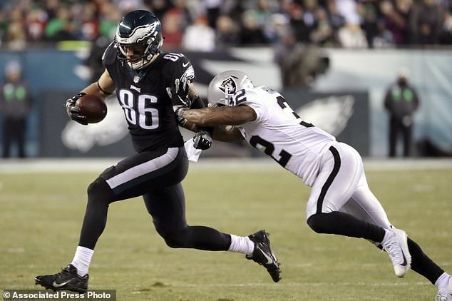 Philadelphia Eagles' Zach Ertz (86) is tackled by Oakland Raiders' Antonio Hamilton (32) during the first half of an NFL football game, Monday, Dec. 25, 2017, in Philadelphia. (AP Photo/Michael Perez)