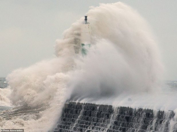 Britain faces an Arctic blast from the next day to come after Storm Eleanor lashed the nation (pictured: waves rupture over the stone jetty wall in Aberystwyth)