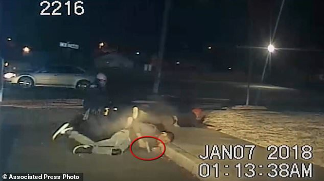Police have released a dramatic dashcam video showing a 17-year-old pull a gun (circled) and fire it during a traffic stop before officers fired back, killing him