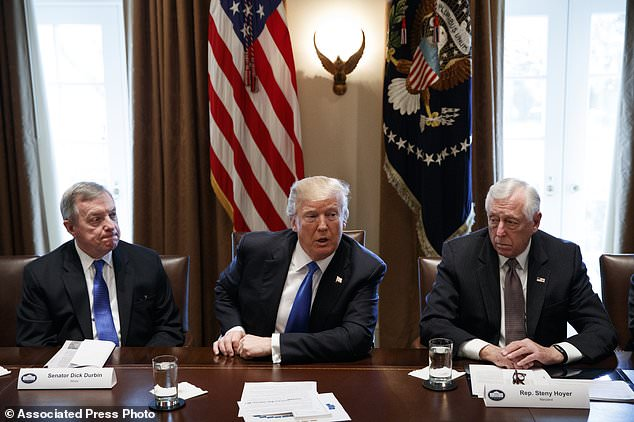 This January 9 photo shows, from left to right, Dick Durbin, Trump and Steny Hoyer (a Maryland Democrat) during a meeting with lawmakers on immigration policy