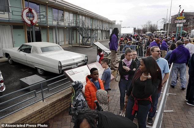 FILE - In this Monday, Jan. 16, 2017, file photo, people wait in line to enter the National Civil Rights Museum on Martin Luther King Jr. Day in Memphis, Tenn. The site is among about 130 locations in 14 states being promoted as part of the new U.S. Civil Rights Trail, which organizers hope will boost tourism in the region. (AP Photo/Mark Humphrey, File)