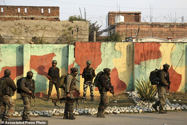 Indian Army soldiers surround Sunjwan Army camp in Jammu, India, Saturday, Feb.10, 2018. A group of militants in Indian Kashmir opened fire Saturday inside an army camp in the disputed region, police said. The attack began early in the morning and it was unclear how many gunmen were involved, (AP Photo/Channi Anand)