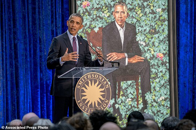 Former President Barack Obama, speaks at the unveiling ceremony for the Obama's official portraits at the Smithsonian's National Portrait Gallery, Monday, Feb. 12, 2018, in Washington. Obama's portrait was painted by Artist Kehinde Wiley. (AP Photo/Andrew Harnik)