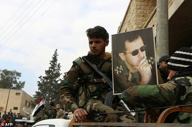Pro-Syrian government fighters deploy in support of Kurds battling Turkish-led rebels in the northwestern enclave of Afrin