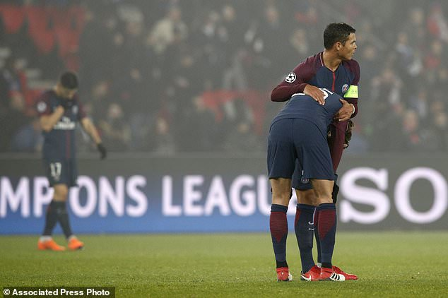 Real Madrid beats PSG 2 1 to reach Champions League      Daily Mail     Captain PSG s Thiago Silva  right  hugs PSG s Adrien Rabiot after the  Champions League round