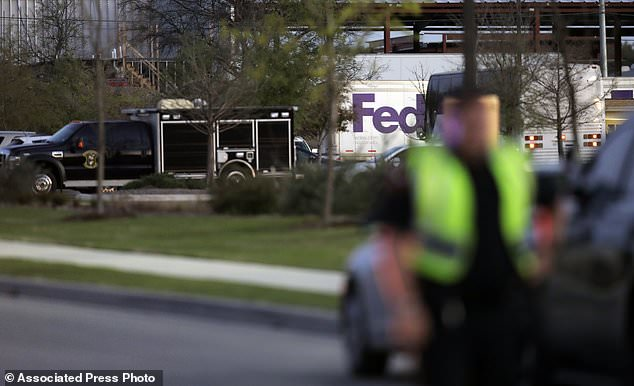 Emergency vehicles sit in front of a FedEx distribution center where a package exploded, Tuesday, March 20, 2018, in Schertz, Texas. Authorities believe the package bomb is linked to the recent string of Austin bombings. (AP Photo/Eric Gay)