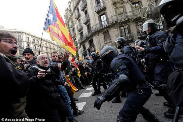 The Latest: 52 injured, 3 arrested in Catalonia clashes ...