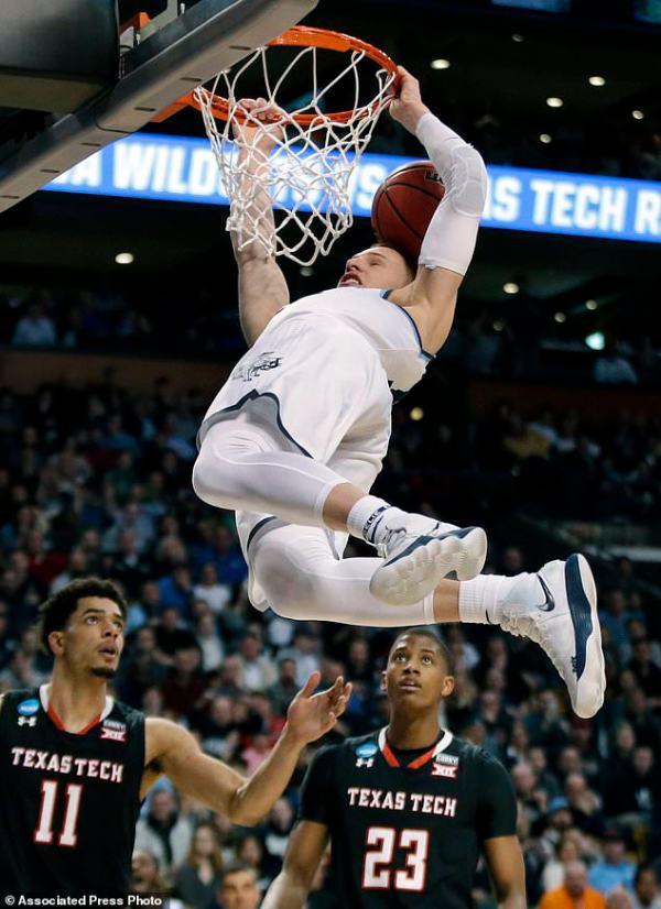 NCAA Latest: Kansas gets past Duke in OT classic for ...