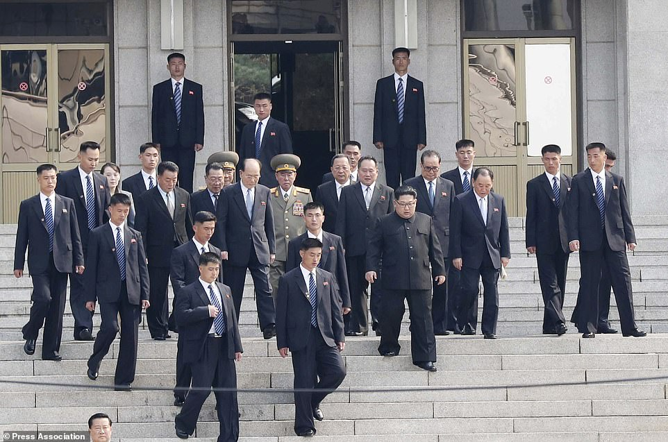 Mr Kim, centre right, arrives with his delegation at the north side of the Demilitarized Zone while Moon remained on the south side