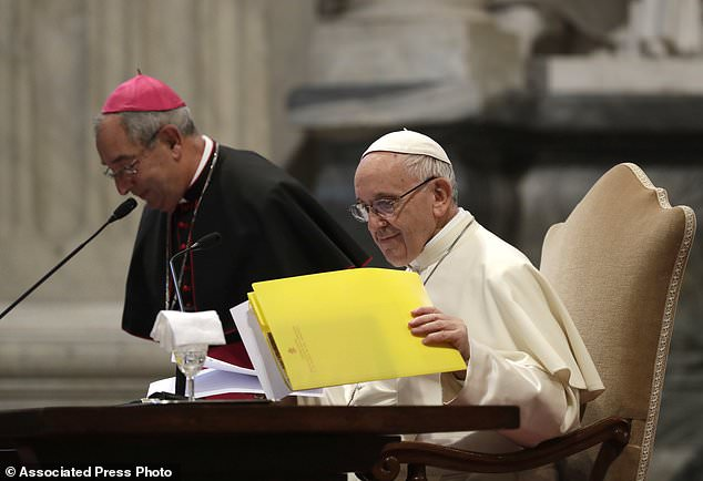 Pope Francis, flanked by Bishop Angelo De Donatis, sits during a meeting with the Roman diocese, at the Vatican Basilica of St. John Lateran, in Rome, Monday