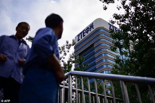 The deal with ZTE, whose logo is shown on a building in Beijing, comes as the US and China engage in separate and fraught trade talks
